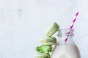 Milk in jar with straw and macaroon tower