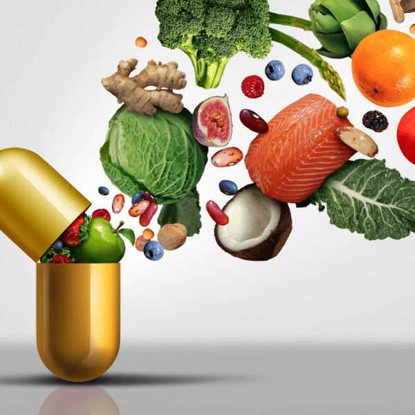 Vegetables and fruit coming out of a supplement capsule